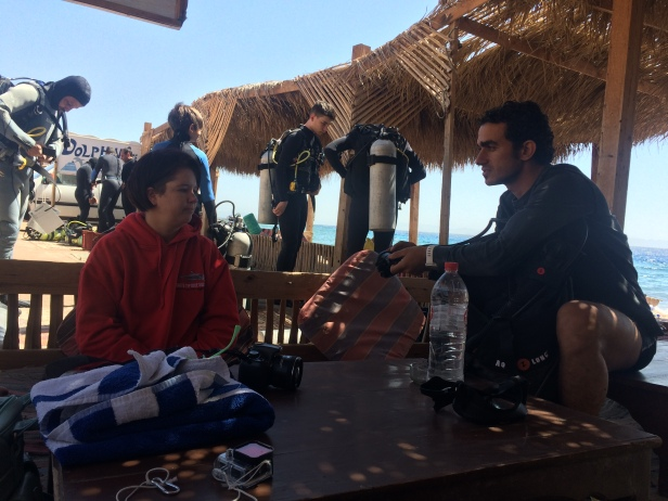 Kelli listening to Bassem's wise words of diving.